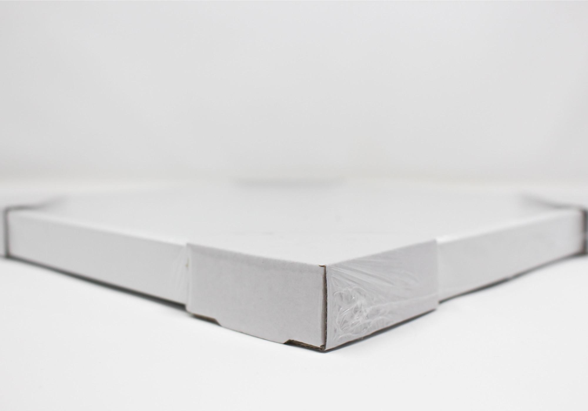 Détails emballage cadre carré blanc au format 20x20cm